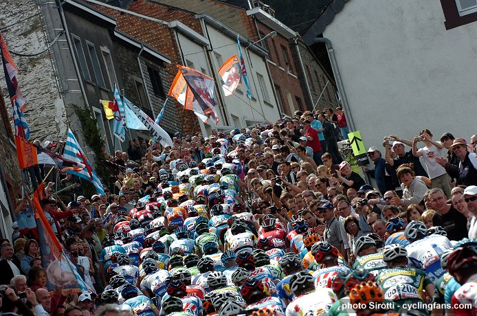 The peloton climbs through a large crowd during the 2008 Liege-Bastogne-Liege