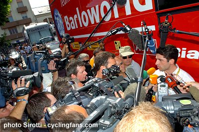 2008 Tour de France:  A Team Barloworld official speaks to the world media after the announcement of the doping positive by rider Moises Dueñas Nevado