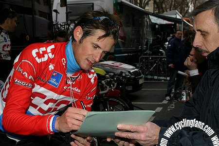 Frank Schleck (CSC) signs an autograph before the 2006 Paris-Nice prologue